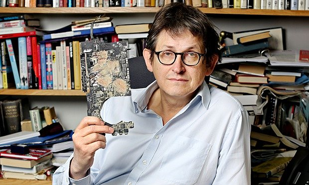 Alan Rusbridger holding the destroyed Snowden files hard disk